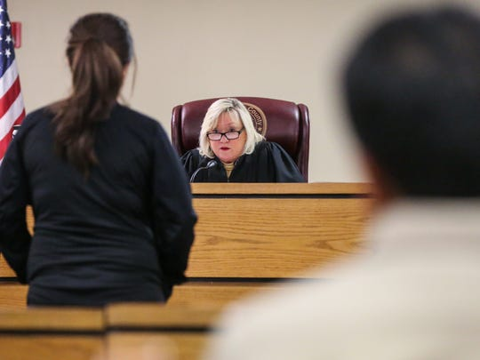 Judge Penny Roberts talks to a participant of drug