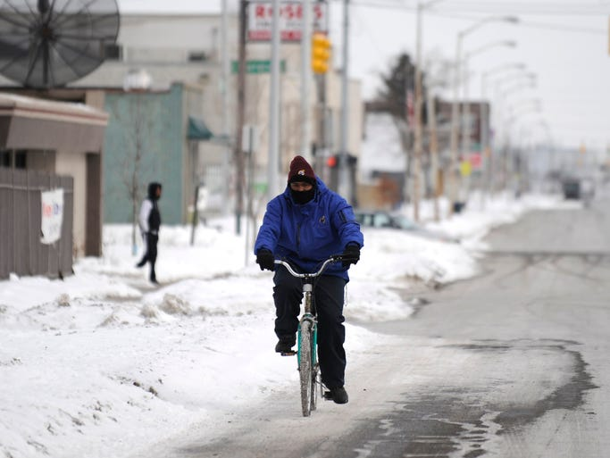 Dwayne Terry of Detroit rides his bike on a cold day