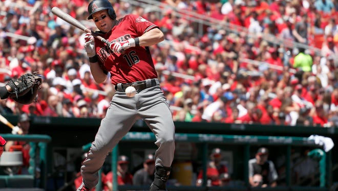 Arizona Diamondbacks' Chris Owings recoils after being hit while trying to bunt during the second inning of a baseball game Sunday, July 30, 2017, in St. Louis. Owings left the game due to injury after the play. (AP Photo/Jeff Roberson)