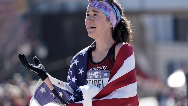 Molly Seidel celebrates after placing second in the women's race during the US Olympic Team Trials marathon last February