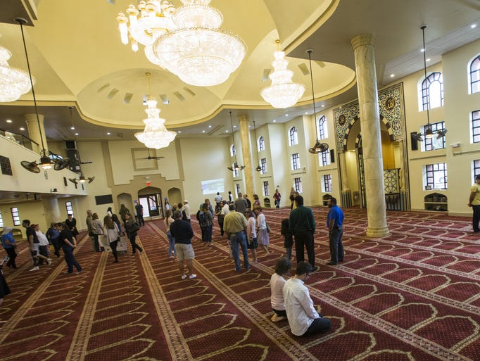 People of all faiths enter to look through the mosque