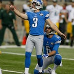 Detroit Lions Nate Freese watches his made field goal off the hold of Sam Martin for a 12-7 first half lead over the Green Bay Packers in their football game in Detroit on Sunday, September 21, 2014.