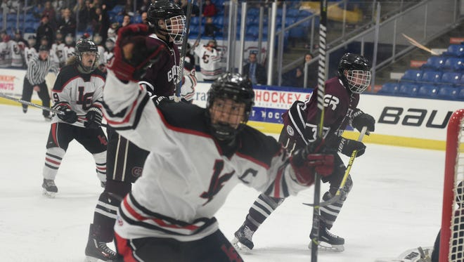 Churchill's Josh Friend celebrates his first of two goals leading the Chargers to a 3-1 semifinal victory over Gabriel Richard.