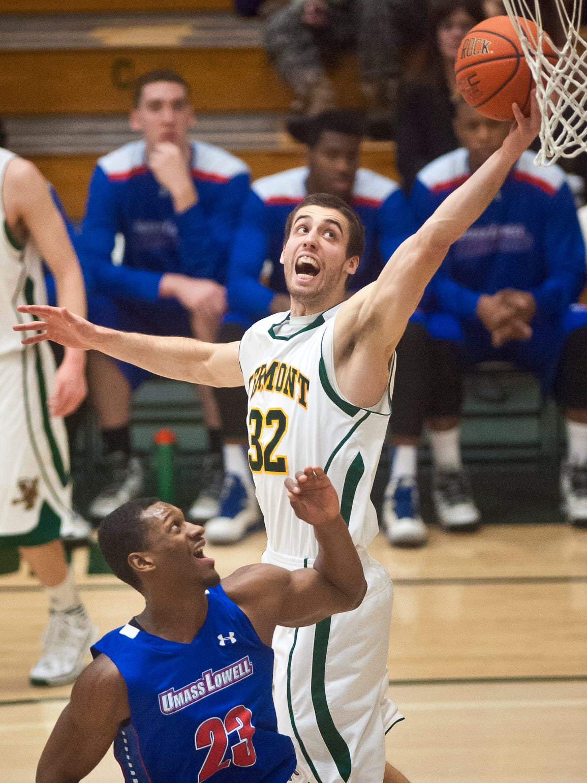 Vermont's Ethan O'Day grabs a rebound over UMass-Lowell's