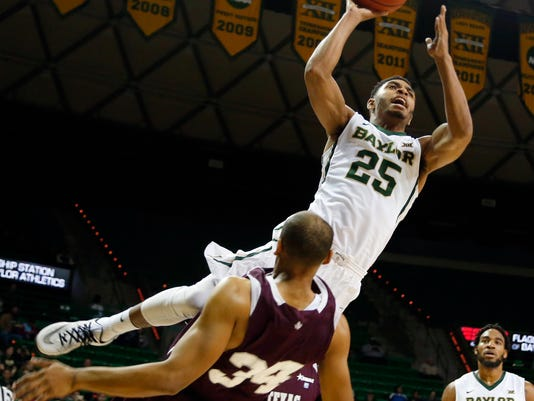Baylor guard Al Freeman (25) drives over Texas Southern center Christian McCoggle (34), left, in the first half of an NCAA college basketball game, Monday, Dec. 1, 2014, in Waco, Texas. (AP Photo/The Waco Tribune-Herald, Rod Aydelotte)