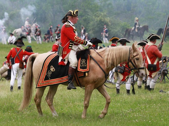 A re-enactment of the Battle of Monmouth at Monmouth Battlefield State Park in 2013.