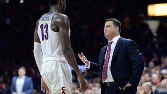 Arizona Wildcats head coach Sean Miller talks to Deandre Ayton during a Dec. 18, 2017 game against North Dakota State at McKale Center.