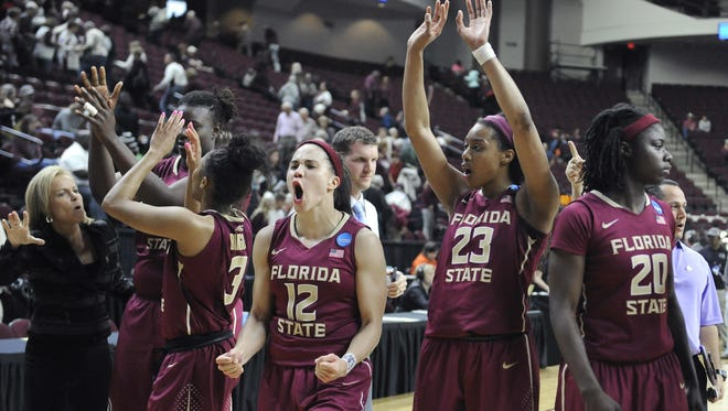 Florida State's Brittany Brown (12) and teammates celebrate their 74-56 win over Texas A&M in the second round of the NCAA tournament.