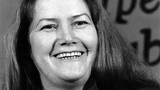 """In this file photo, Australian author Colleen McCullough laughs during a news conference in New York. Best-selling author McCullough, whose novel """"The Thorn Birds"""" sold 30 million copies worldwide, has died at age 77 after a long illness. McCullough died today in hospital on remote Norfolk Island, HarperCollins Australia publishing director Shona Martyn said in a statement."""