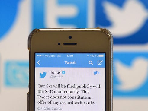 A Twitter tweet announcing the company's planned IPO pictured on smartphone.