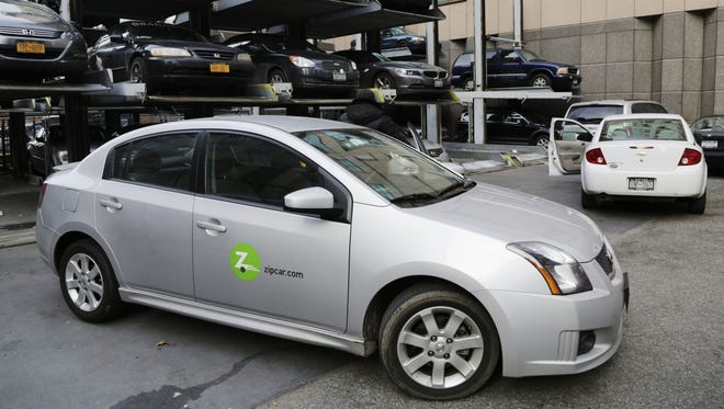 Zipcar, the popular car-sharing service, is closing its Detroit office and partnering with Uber.