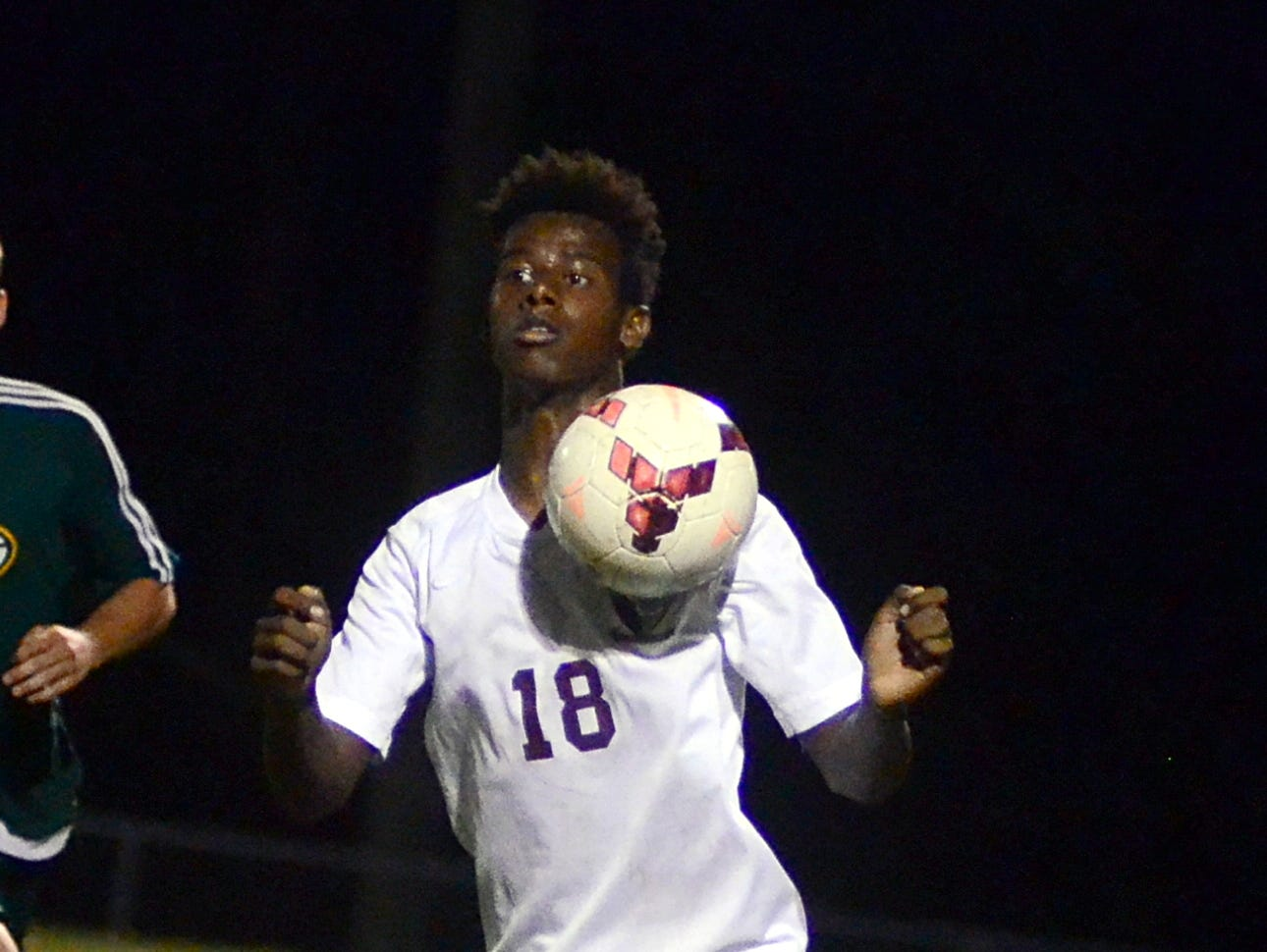 Station Camp High sophomore Atakelti Gebrezgabher plays the ball off of his chest during first-half action.