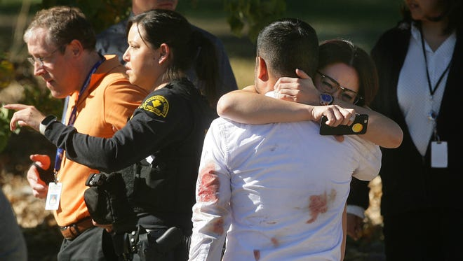 A couple embraces following a shooting that killed multiple people at a social services facility, Dec. 2, 2015, in San Bernardino, Calif.