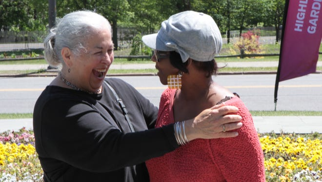 Roberta Gordon, left, embraces former second-grade student Jacquelyn Dobson of Rochester. Dobson was one of several of Gordon's former students to arrive for a second-grade class reunion at the pansy bed in Highland Park.