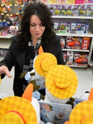 Nicole Tatusko shops for an Olaf doll at Wal-Mart during