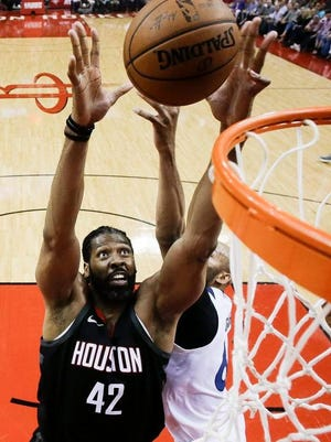 Houston Rockets center Nene (42) and Minnesota Timberwolves forward Taj Gibson vie for a rebound during the first half in Game 5 of a first-round NBA basketball playoff series Wednesday, April 25, 2018, in Houston.
