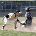 Action from the Corning-Painted Post baseball team's 9-4 win over Elmira in a Section 4 Class AA baseball semifinal Tuesday at Corning-Painted Post High School.