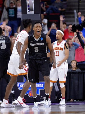 Rodney Bullock of the Providence Friars celebrates after hitting a basket late in the second half against the USC Trojans during the first round of the 2016 NCAA Men's Basketball Tournament at PNC Arena .