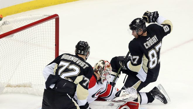 Pittsburgh Penguins center Sidney Crosby (87) scores a goal against Carolina Hurricanes goalie Eddie Lack (31) during the second period at the CONSOL Energy Center.