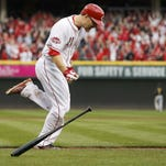 Todd Frazier celebrates his three-run home run in the eighth inning on opening day to help the Reds beat the Pittsburgh Pirates.