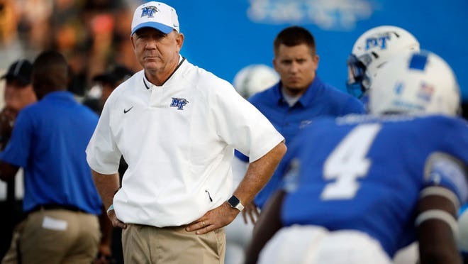 Middle Tennessee head coach Rick Stockstill watches as players warm up before an NCAA college football game against Vanderbilt Saturday, Sept. 2, 2017, in Murfreesboro, Tenn. (AP Photo/Mark Humphrey)