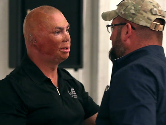 Staff Sgt. Shilo Harris, a veteran wounded by an IED in Iraq, shakes the hand of Chris Gill, founder of Lone Star Warriors Outdoors, after speaking to other active duty service members and veterans during a banquet in their honor on Thursday evening.