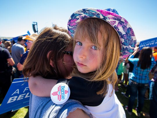 Sarah Wilson, left, and her 5-year-old daughter Katrina Wilson wait at Vado Elementary School in Vado, NM for a rally to start by presidential candidate Senator Bernie Sanders, May 21, 2016. People began lining up for Sander's scheduled 12pm speech as early as 5am.