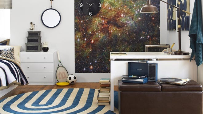 Temporary, adhesive murals and attractive bedding can make a room pop.