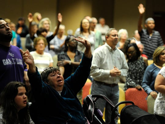 Worshipers pray together during the National Day of Prayer Celebration on Wednesday, May 3, 2017, at New Hope Church. There will be two National Day of Prayer services in Abilene on Thursday. The BCFS Health and Human Services program is Thursday morning for people who previously made reservations. Abilene Interfaith Council is having a prayer service at noon at the Center for Contemporary Arts, 220 Cypress St.