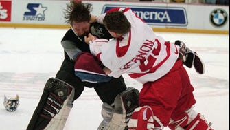 FILE--Colorado Avalanche goaltender Patrick Roy, left, takes a punch from Detroit Red Wings' goaltender Mike Vernon during a first period brawl in Detroit March 26, 1997. The NHL wants the Avalanche and the Red Wings on best behavior when the Western Conference finals begin Thursday. General managers of have been warned that savagery such as the 148 minutes in penalties that marred the March 26 game will not be tolerated.(AP Photo/Tom Pidgeon) ORG XMIT: NY173