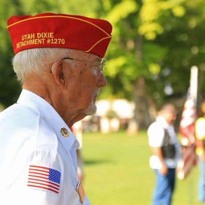 Gordon Farr, of Marine Corps League 1270, listens to