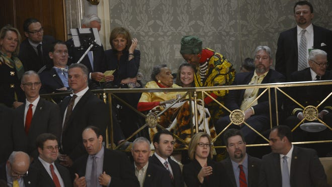 1/20/15 {time} -- Washington, DC, U.S.A  -- Amelia Boynton Robinson, 103, center  seated with gold blouse, attends President Barack Obama's State of the Union address on Tuesday, Jan. 20, 2015 from the House chamber of the United States Capitol in Washington. She was beaten during Bloody Sunday, a scene depicted in the Selma movie. She is from Tuskegee, Alabama, and is a guest of Rep. Terri Sewell, D-Birmingham. --    Photo by Jack Gruber, USA TODAY staff (Via OlyDrop)