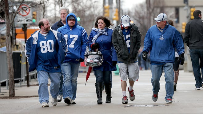 The Indianapolis Colts host the Cincinnati Bengals in the AFC Wild Card game Sunday, January 4, 2015, afternoon at Lucas Oil Stadium. Colts fans walk into the wind as they headed to the stadium.