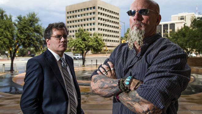 Attorney James Reed, left,  and his client, Jay Dobyns, stand outside the United States District Court building in Tucson, Tuesday, October 6, 2015.  The building where Dobyns spent much of his career as an ATF agent is in the background.