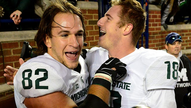 Michigan State tight end Josiah Price celebrates with quarterback Connor Cook after a thrilling, last-second 27-23 victory over Michigan Saturday, October 17, 2015, in Ann Arbor.