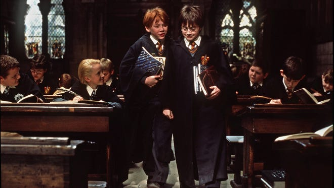 "Actors Rupert Grint as Ron Weasley, left, and Daniel Radcliffe as Harry Potter in the first film, ""Harry Potter and the Sorcerer's Stone."""