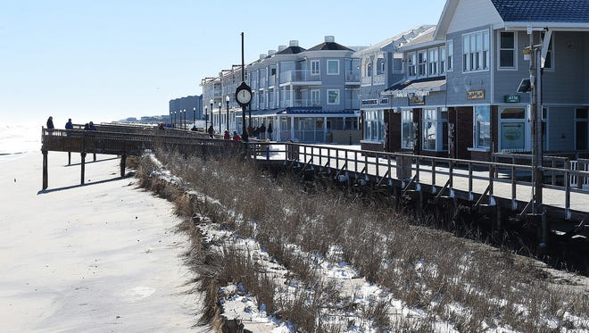 Beach erosion in downtown Bethany Beach.  Clean up has started even as flood waters still remain from the winter storm that came throughout the coastal Jan. 22-24.