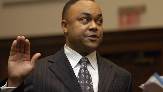 Hinds County District Attorney Robert Shuler Smith is shown taking the oath of office in a file photo.