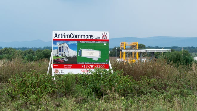 A sign in Antrim Commons Business Park  shows a planned building. Except for one warehouse, the business park in Antrim Township, pictured on Wednesday, August 17, 2016, is so far mostly an open space.