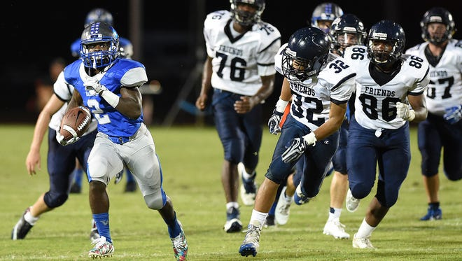 Woodbridge's #2 Terrique Riddick, seen here against Wilmington Friends, scores three touchdowns in the Blue Raiders' win over Indian River on Friday.