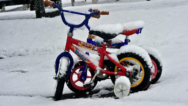Abandoned kid bikes collect snow on Friday, March 10, 2017 at Chambersburg Memorial Park.  An early morning storm brought snow to the Franklin County area.