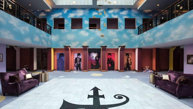 Tours begin in the lofty atrium, where Prince's cremains are stored in a miniature version of Paisley Park that is encased on a wall.