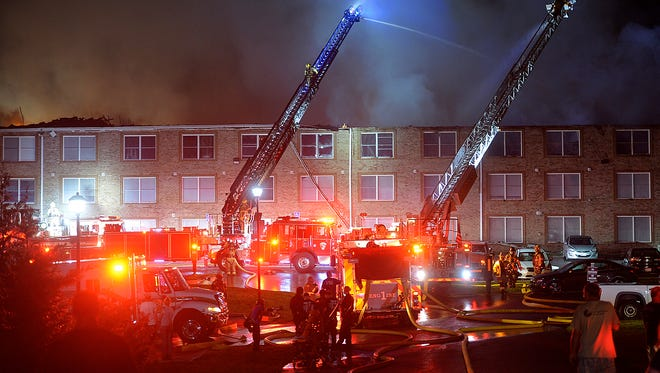 A large fire broke out at a Woodbridge Apartments building along Robinwood Drive near Hagerstown, Md., Tuesday night, Aug. 22, 2017. The Maryland State Fire Marshal's office says the fire late Tuesday in the three-story apartment building in Hagerstown started when lightning struck the roof. The fire marshal's office says no injuries have been reported, and all 74 residents have been accounted for.