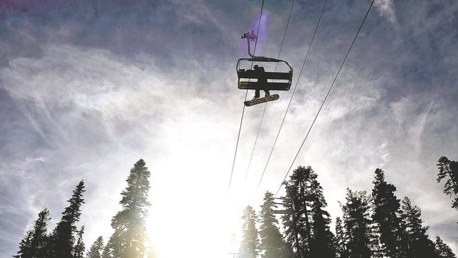 A snowboarder rides on the Comstock Lift at Northstar California in this undated photo.
