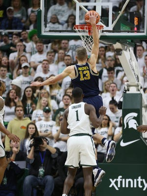 Michigan forward Moritz Wagner scores against Michigan State guard Joshua Langford in the first half Saturday, Jan. 13, 2018 at the Breslin Center in East Lansing.