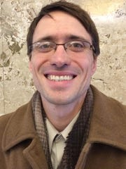 Jay Kronenwetter poses for a photo in Wausau's City