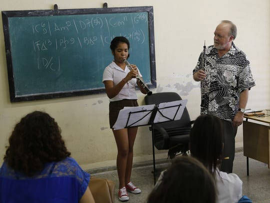 Cuban National Art School student Betsy Brizuela plays the oboe as Minnesota Orchestra oboe player John Snow conducts a master class in Havana, Cuba, on Thursday.
