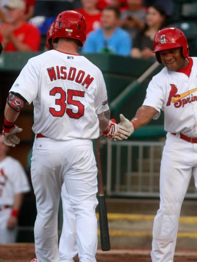 Springfield Cardinal Patrick Wisdom is greeted at the plate by a teammate after hitting a home run against the Corpus Christi Hooks at Hammons Field on Thursday, June 26, 2014.
