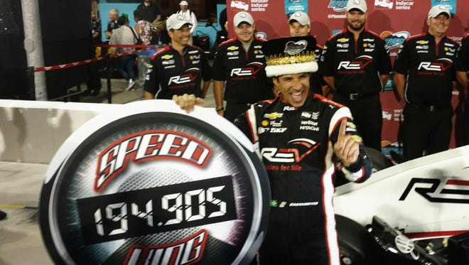 Helio Castroneves set a new track record en route to winning his second pole position of the season Friday night at Phoenix International Raceway.