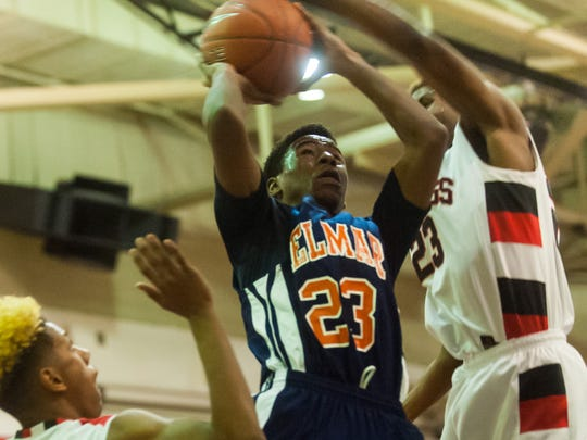 Delmar small forward Shyheim Mitchell (23) puts up a shot up against Laurel forward Chuckie Auguste (23) who fouls Mitchell on the play at Laurel High on Thursday night.